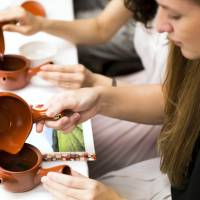 Attendees make Japanese tea during a cultural experience program, part of Mitsubishi UFJ Financial Group's Global Analyst Program for training top graduates, at the Happo-en garden in Tokyo on July 17. | BLOOMBERG