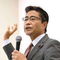Lower House member Masaru Wakasa speaks at a news conference at the Diet on Monday. The independent lawmaker announced the launch of the political group Nippon First no Kai (Japan First). | KYODO