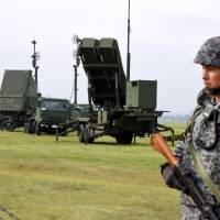 Air Self-Defense Force personnel conduct a scheduled anti-missile drill involving a Patriot Advanced Capability-3 missile unit at the U.S. Yokota Air Base in Fussa, on the outskirts of Tokyo, on Tuesday. | SATOKO KAWASAKI