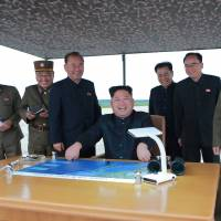 North Korean leader Kim Jong Un oversees a ballistic missile drill in this photo released Wednesday. | KCNA / VIA REUTERS