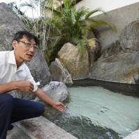 Tetsuya Morooka has been offering disaster victims and volunteers free entry to the hot springs at his traditional inn in Asakura, Fukuoka Prefecture.   KYODO