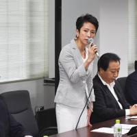 Outgoing Democratic Party chief Renho speaks to party members at a meeting Tuesday at the party headquarters in Tokyo. The main opposition is set to choose its new leader on Sept. 1. | KYODO