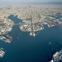The Osaka port is seen in an aerial view in December 2016. This year, Osaka is celebrating the 150th anniversary of the opening of its port to the outside world.   KYODO