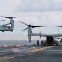 U.S. Marine MV-22B Osprey lands on the deck of the USS Bonhomme Richard during events marking the start of the Talisman Saber 2017 joint military exercise off the coast of Sydney on June 29. | REUTERS