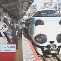 A Kuroshio limited express train repainted to resemble the face of a giant panda departs from JR Tennoji Station in Osaka on Saturday. | KYODO