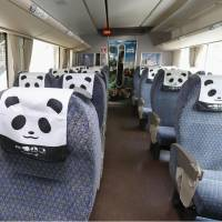 This Kuroshio express train, which has seat covers designed as panda faces, departs JR Tennoji Station in Osaka for Shirahama Station in Wakayama Prefecture on Saturday. | KYODO