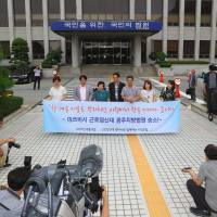 A group of activists working for former forced laborers hold a press conference at the district court in the southern city of Gwangju on Tuesday after the court ruled Mitsubishi Heavy Industries should pay compensation to two South Koreans. | AFP-JIJI