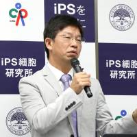 Jun Takahashi of Kyoto University briefs reporters Aug. 24 on the university's research, in which human induced pluripotent stem cells (iPS cells) were found to be effective in treating monkeys with Parkinson's disease. | KYODO