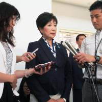 Tokyo Gov. Yuriko Koike speaks to reporters Monday after a special session of the metropolitan assembly. | KYODO