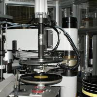 Record pressing and trimming equipment at Sony DADC Japan Inc. is shown in this handout photo.   COURTESY OF SONY MUSIC ENTERTAINMENT (JAPAN) INC. / VIA KYODO