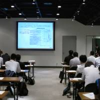 Attendees listen to a seminar on virtual currencies hosted by Fisco Ltd. last week in Tokyo. | KAZUAKI NAGATA