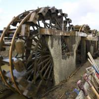 Kyushu city's historic water wheels begin turning again after deluges