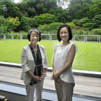 Philanthropist Atsuko Fish (left), founder of the Japanese Women's Leadership Initiative, and program manager Kozue Sawame pose for a photo at the International House of Japan in Tokyo on June 22. | KYODO