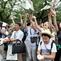 Visitors to Yasukuni Shrine in Tokyo release doves in a gesture of peace on Tuesday, the 72nd  anniversary of Japan's surrender in World War II. | YOSHIAKI MIURA