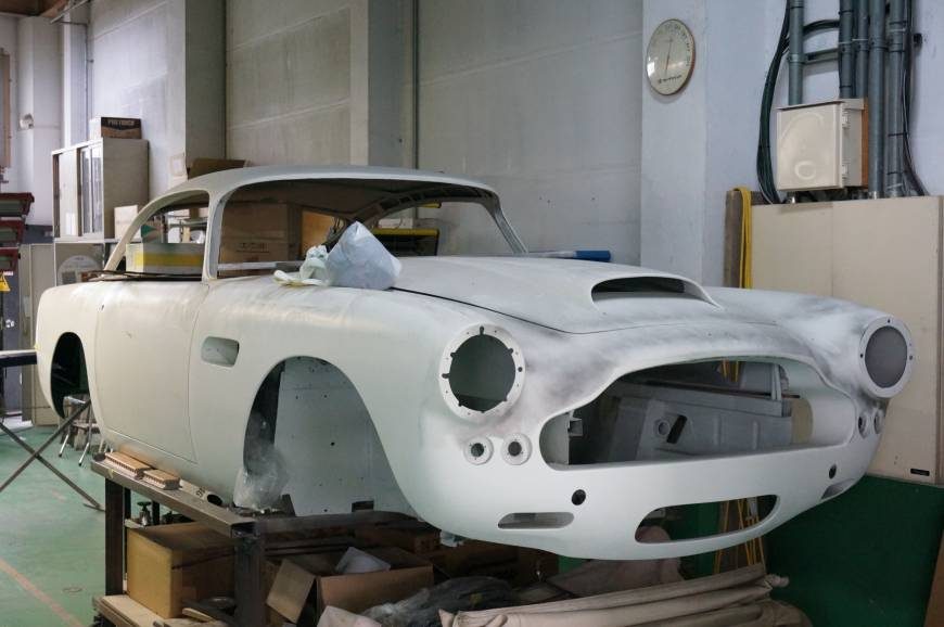 An Aston Martin DB4 is undergoing restoration work at Garage Igarashi, one of the country