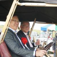 Two men sit in a 1910 Rolls-Royce Silver Ghost, one of the oldest registered cars in Japan, at the Wakui Museum in Saitama Prefecture.   PARKER J. ALLEN