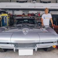 George Tokoro stands next to his 1964 Chevrolet Corvette Stingray at his Setagaya Base compound in Tokyo's Seijo neighborhood in July. | MARC-ANTOINE ASTIER
