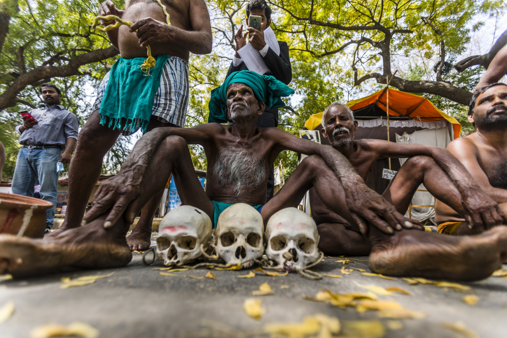 Indian farmers from the  state of Tamil Nadu protest March 24 in New Delhi with the skulls of farmers who committed suicide in their region following devastating crop losses. | BLOOMBERG