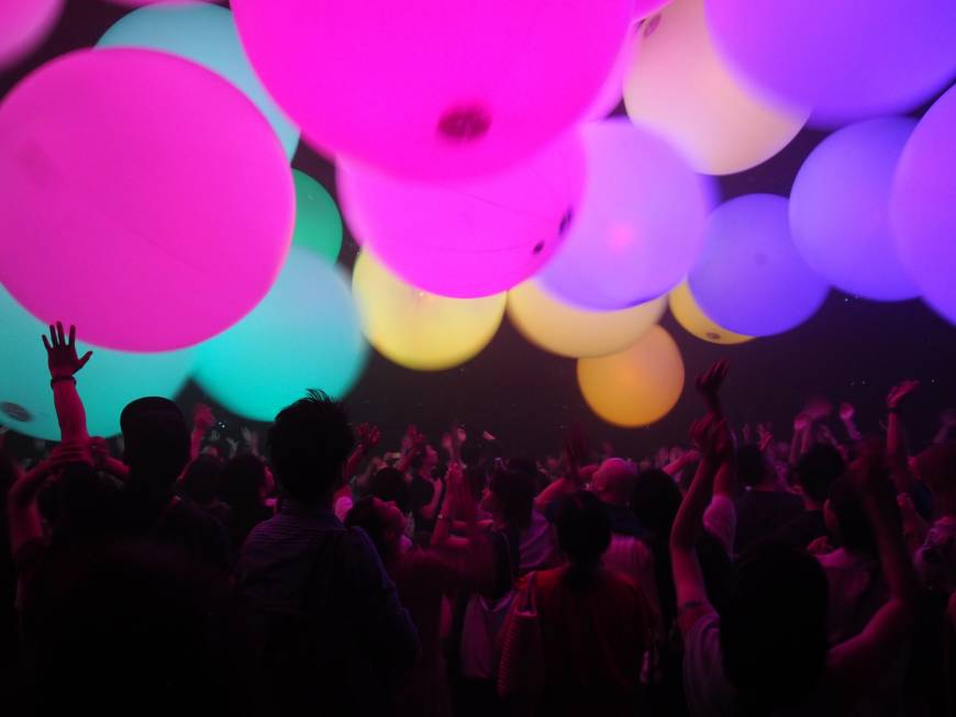 Visitors take part in teamLab Jungle — Light Art and Music
