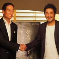 TeamLab founder Toshiyuki Inoko (right) and Shiseido CEO Masahiko Uotani pose for a photograph at a press preview of 'A Forest Where Gods Live' in the city of Takeo, Saga Prefecture. | COURTESY OF TEAMLAB