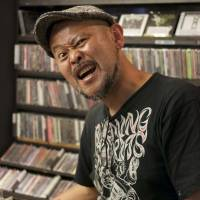 Take action: Shinji 'Guy' Okoda stands in Disk Shop Misery in Hiroshima's Naka Ward, a record shop where every section is devoted to punk music. | PETER CHORDAS