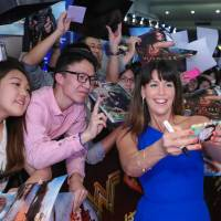 The talk of the town: Director Patty Jenkins takes pictures with fans at the Shanghai premiere of her film 'Wonder Woman.' | © 2017 WARNER BROS. ENTERTAINMENT INC. AND RATPAC-DUNE ENTERTAINMENT LLC