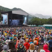 Rainy plain: Australian rockers Jet perform on the main Green Stage at Fuji Rock Festival on Sunday. People began arriving at Naeba Ski Resort in Niigata Prefecture on Thursday night last week for a weekend of musical performances. | JAMES HADFIELD