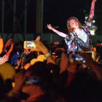 Take to the crowd: Wednesday Campanella's Kom_I floats across the crowd during a performance at the Red Marquee on Sunday night. | JAMES HADFIELD
