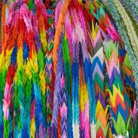 Shades of peace: Thousands of paper cranes are hung as symbols of a world without violence. | STEPHEN MANSFIELD