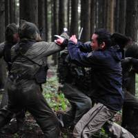 Rough and tumble: Taku 'Tak' Sakaguchi plays a modern-day Rambo in Yuji Shimomura's action flick 'Re:Born.' © 2016 'RE:BORN' PARTNERS. ALL RIGHTS RESERVED