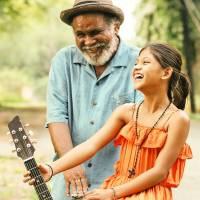 Finding friendship: Japanese director Kohki Hasei's debut feature-length film, 'Blanka,' follows the story of a young girl (Cydel Gabutero) looking for a mother figure. She befriends a blind guitar player named Peter (Peter Millari) on her journey. | © 2015-ALL RIGHTS RESERVED DORJC FILM