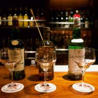 Pick your poison: Three of Bar Leichhardt's 3,000 bottles stand atop the bar. | OSCAR BOYD