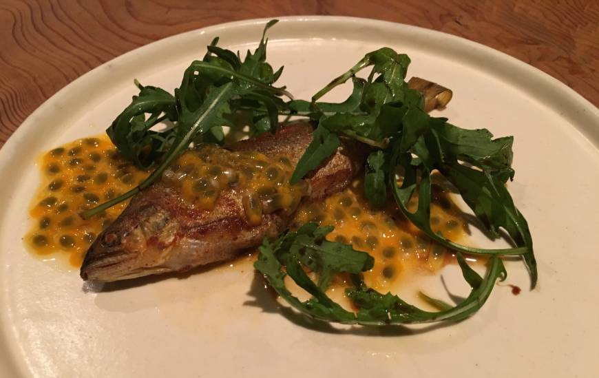 <em>Ayu</em> (sweetfish) confit, served with a passion fruit sauce at Umbilical in Sangenjaya. | ROBBIE SWINNERTON