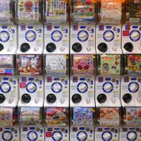 Facing page: Capsule toy vending machines at the Animate store in Tokyo's Shibuya district. | ANDREW LEE