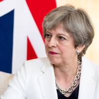 British Prime Minister Theresa May is leading a business delegation to Japan on Wednesday. Her primary interest will be to expand exports and remove trade barriers. | BLOOMBERG