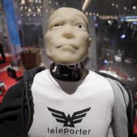 Modern look: A Mars Electric Inc. Teleporter humanoid robot sits on display during Slush Tokyo in March. The student-driven startup event is seeking to ignite the entrepreneurial spirit in Japanese youth. | BLOOMBERG