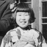 Stigma remains: Keiko Ogura is pictured in 1946. Her family members were cropped out because they do not want to be associated with the atomic bombing. | COURTESY OF KEIKO OGURA