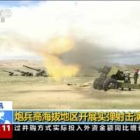 Chinese troops conduct a live-fire drill in China's Tibet Autonomous Region that borders India. Beijing is intensifying its warnings to New Delhi to pull its troops out of a contested region high in the Himalayas, saying China has been restrained, but 'restraint has its limits.' | AP