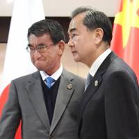 Foreign Minister Taro Kono and his Chinese counterpart Wang Yi didn't mince words when they met at the East Asia Summit Foreign Ministers' Meeting on Aug. 7 in Manila. | KYODO