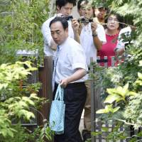 Arrested for fraud: Yasunori Kagoike leaves his house for a second round of questioning by prosecutors on July 31. | KYODO