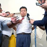 Democratic Party  Secretary-General Yukio Edano, shown talking to reporters on July 29, has his work cut out.   KYODO