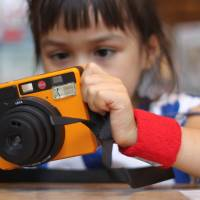 Learning to become snap happy with an instant camera in Japan