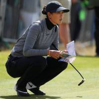 Michelle Wie lines up a putt during the first round of the Women's British Open on Thursday in St. Andrews, Scotland. | ACTION IMAGES VIA REUTERS