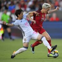 Yuka Momiki (left) and the United States' Megan Rapinoe vie for the ball during their match on Thursday in Carson, California. The U.S. beat Japan 3-0. | AP
