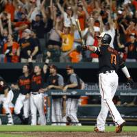 Machado's slam sinks Angels