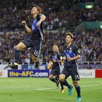 Japan's Takuma Asano celebrates his first-half goal against Australia in a World Cup qualifer on Thursday night at Saitama Stadium. Japan defeated Australia 2-0. | KYODO