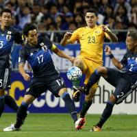 Australia's Tom Rogic competes for the ball with Japan's Yosuke Ideguchi (right) and Makoto Hasebe on Thursday. | AP