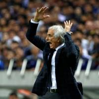 Japan manager Vahid Halilhodzic watches his team take on Australia on Thursday. | REUTERS