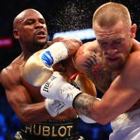 Mayweather stops McGregor with 10th-round TKO