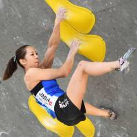 Akiyo Noguchi competes in the final bouldering competition of the World Cup season on Saturday in Munich. | KYODO